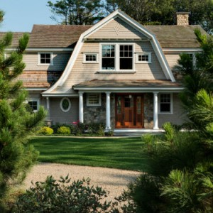 The welcoming front elevation of this TMS-designed seaside gambrel.  Source:  TMS Architects