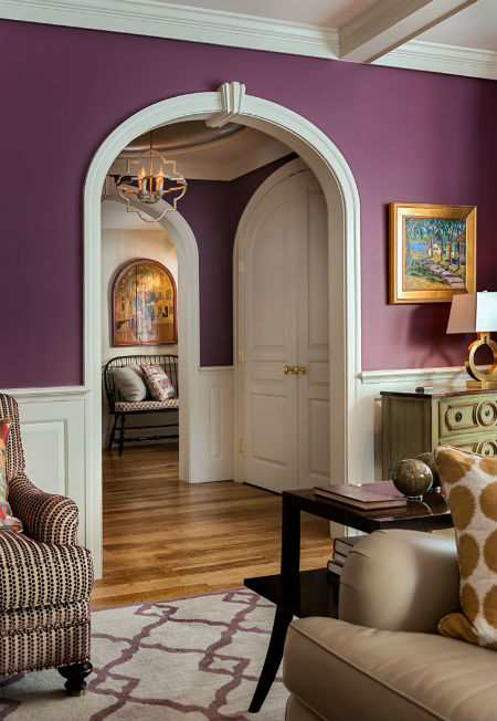Arched  dooreays gracefully lead into the main portion of the home. Source:  Karosis Photography