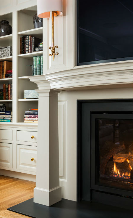 A close-up of a mantle detail illustrates spaces's level of design and craftsmanship. Source: Karosis Photography