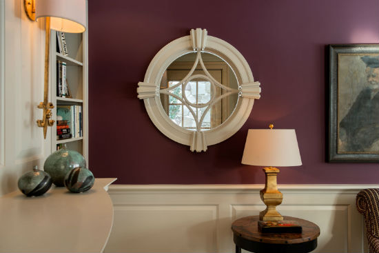 A round window captures natural light from the mudroom as well as a glimpse of the entryway. Source: Karosis Photography