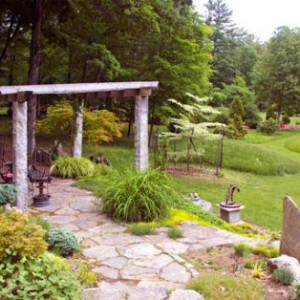 A beautiful stone pergola greets visitors to the gardens. Photograph Courtesy Bedrock Gardens