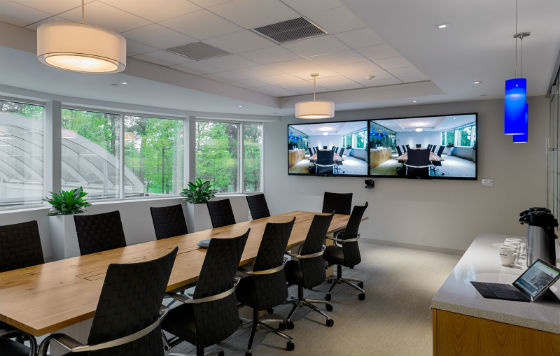 The main conference room with a hickory farmer's style conference table, video conferencing and glass wall.  Source: Rob Karosis Photography
