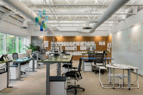The Creative Design Team workstations include height adjustable desks which can be relocated to change the workstation. orientaiton and enhance team productivity.  Source: Rob Karosis Photography