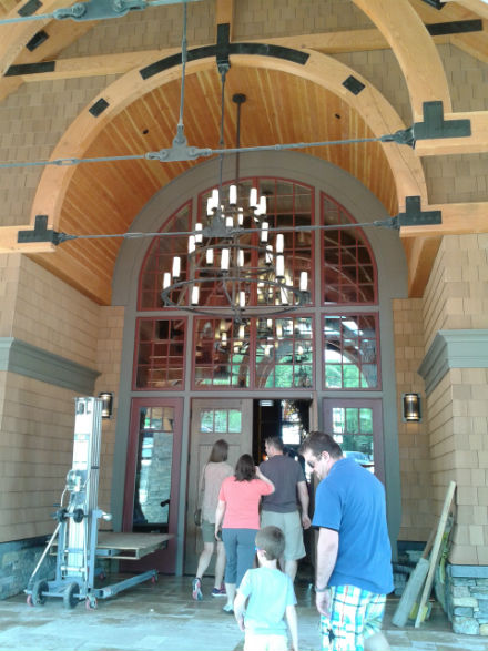 Samia Touma and Tim Giguere passing under one of the many striking light fixtures.