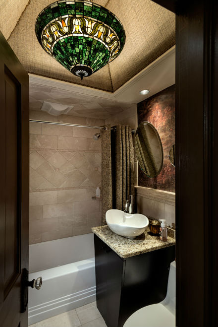 Last but certainly not least is the exquisite bathroom with its beautiful chandelier and contemporary sink. Source: Rob Karosis Photography