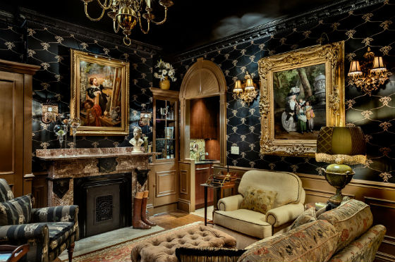 An overview of the living room.  The residence is used primarily in winter months and the design and finishings evoke a cozy and sumptuous nest.  The oil pain tings were located by the homeowners in a New Orleans gallery and range from 1577 to 1828. Source: Rob Karosis Photography