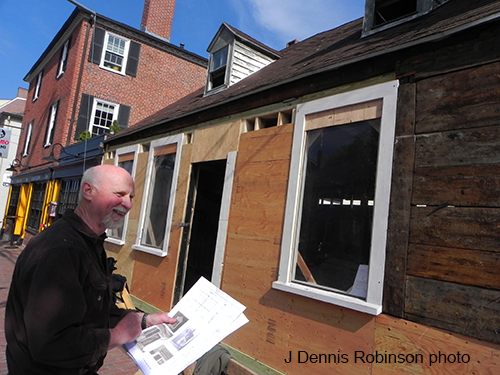 Carpenter Carl Aichele reviews the history of the 1814 Drown House now bing preserved in Downtown Portsmouth. Source: J. Dennis Robinson