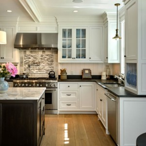 Soapstone is used on these kitchen counters while the island features a marble top. Source:  Karosis Photography